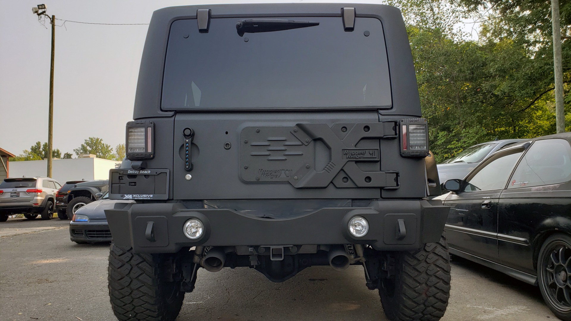 Used 2013 Jeep WRANGLER UNLIMITED FREEDOM EDITION 4X4 / 3.6L / 5-SPD AUTO / ALPINE / CUSTOM for sale $27,999 at Formula Imports in Charlotte NC 28227 5