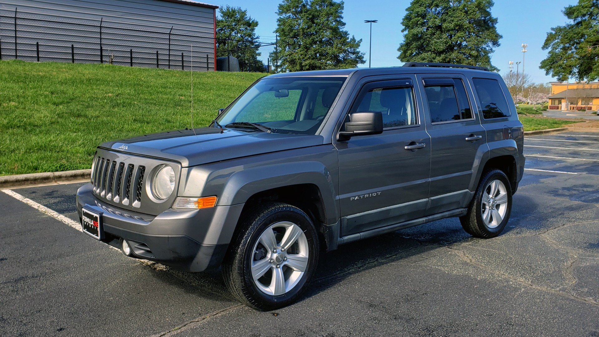 Used 2012 Jeep PATRIOT LATITUDE 4WD / SUNROOF / BOSTON ACOUSTICS SOUND for sale Sold at Formula Imports in Charlotte NC 28227 1