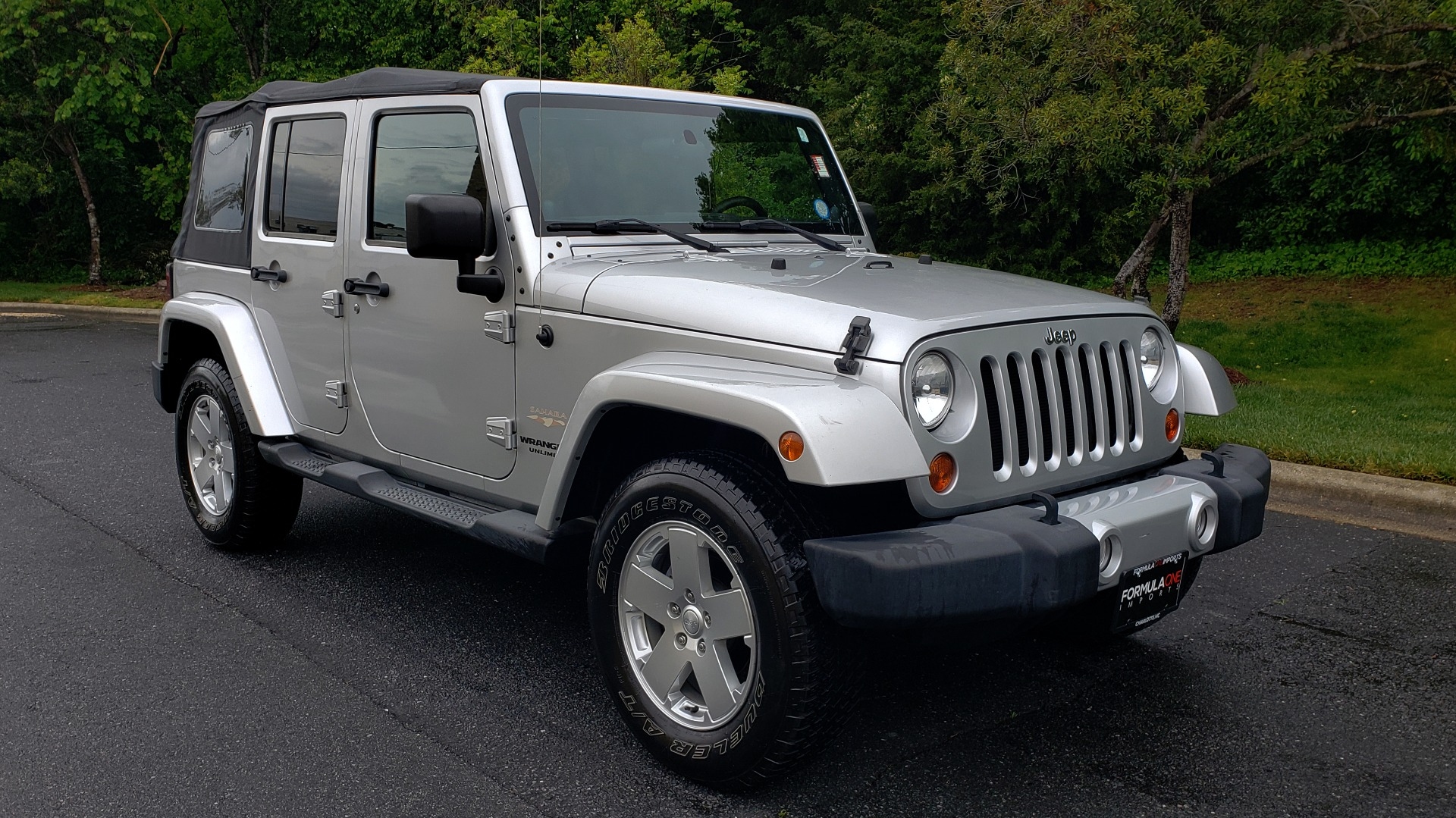 Used 2011 Jeep WRANGLER UNLIMITED SAHARA 4WD / 3-PC FREEDOM TOP / 6-SPD MANUAL for sale Sold at Formula Imports in Charlotte NC 28227 4