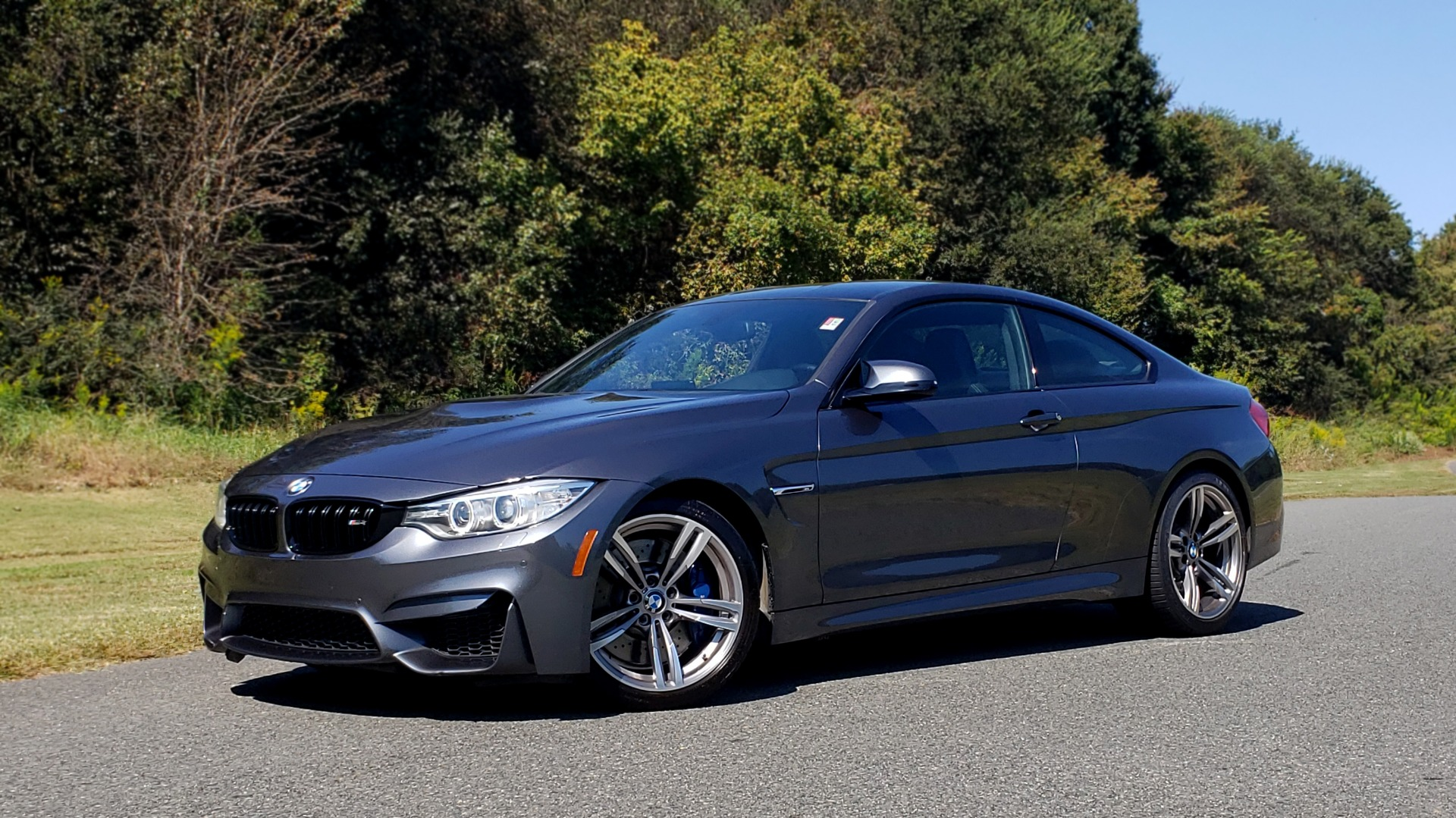 Used 2015 BMW M4 COUPE / EXEC PKG / ADAPT M SUSP / CF ROOF / NAV / REARVIEW for sale Sold at Formula Imports in Charlotte NC 28227 1
