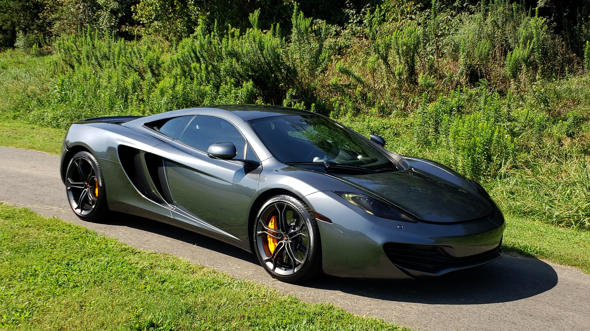 Used 2012 McLaren MP4-12C COUPE / 3.8 L V8 592HP / AUTO / NAV / CCB / LOW MILES for sale $97,999 at Formula Imports in Charlotte NC 28227 19