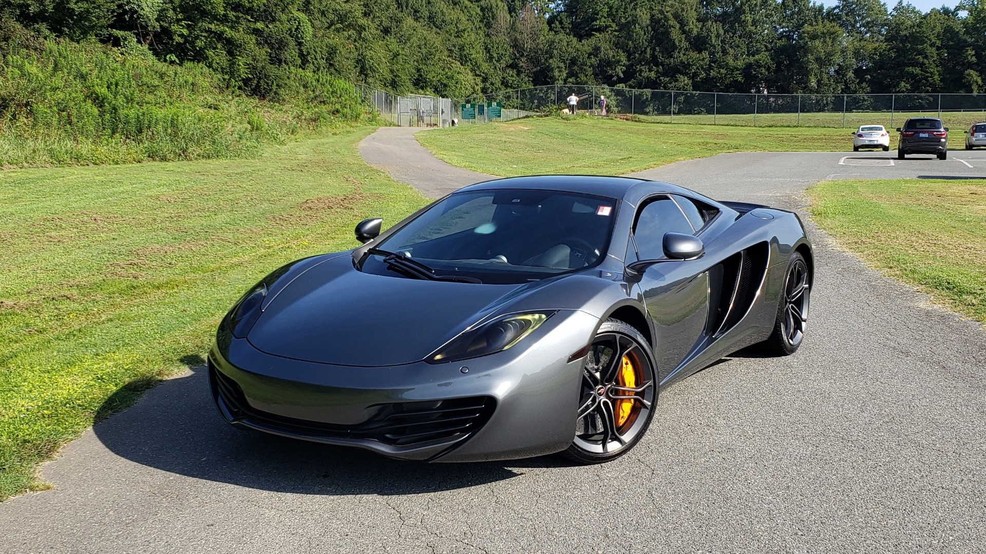 Used 2012 McLaren MP4-12C COUPE / 3.8 L V8 592HP / AUTO / NAV / CCB / LOW MILES for sale $97,999 at Formula Imports in Charlotte NC 28227 2