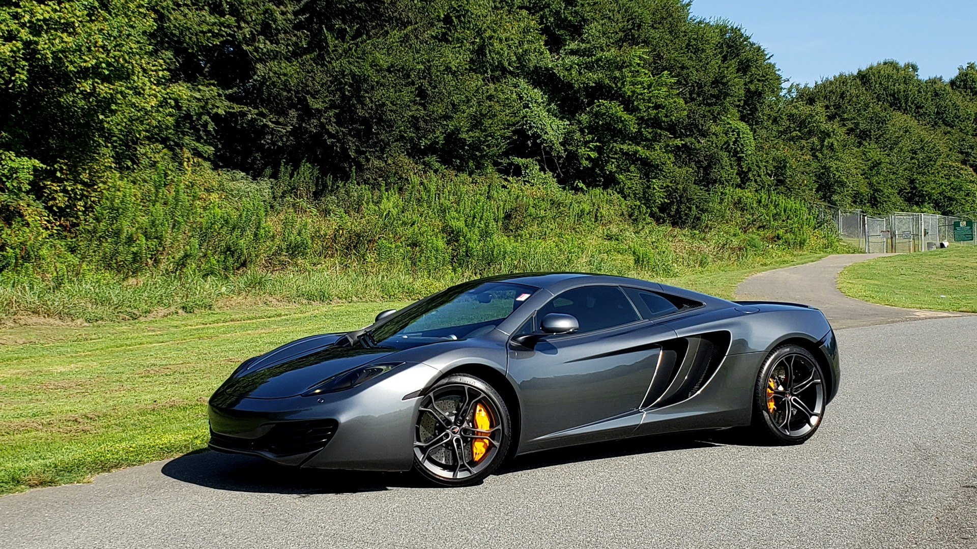 Used 2012 McLaren MP4-12C COUPE / 3.8 L V8 592HP / AUTO / NAV / CCB / LOW MILES for sale $97,999 at Formula Imports in Charlotte NC 28227 7