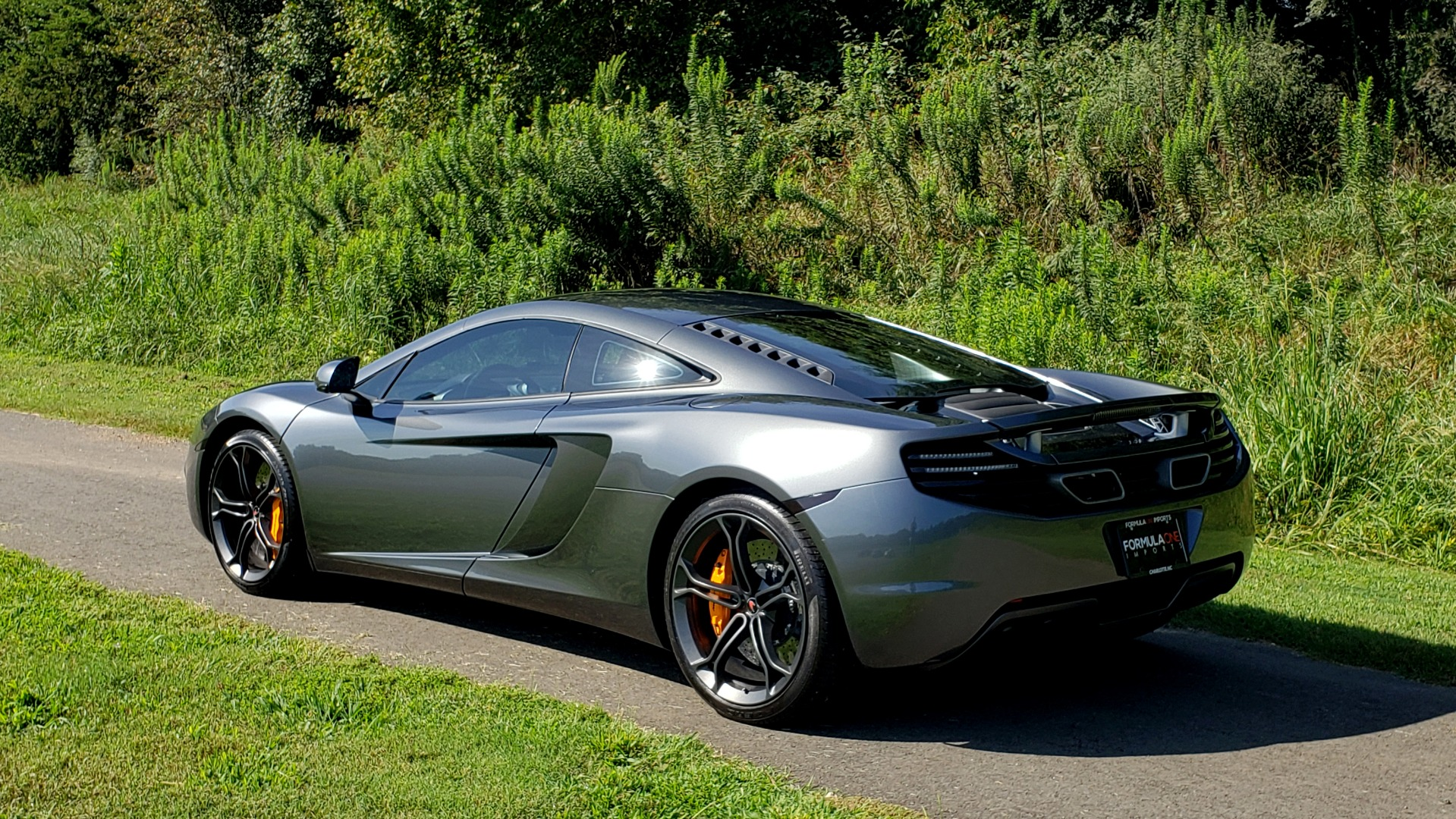 Used 2012 McLaren MP4-12C COUPE / 3.8 L V8 592HP / AUTO / NAV / CCB / LOW MILES for sale $97,999 at Formula Imports in Charlotte NC 28227 9