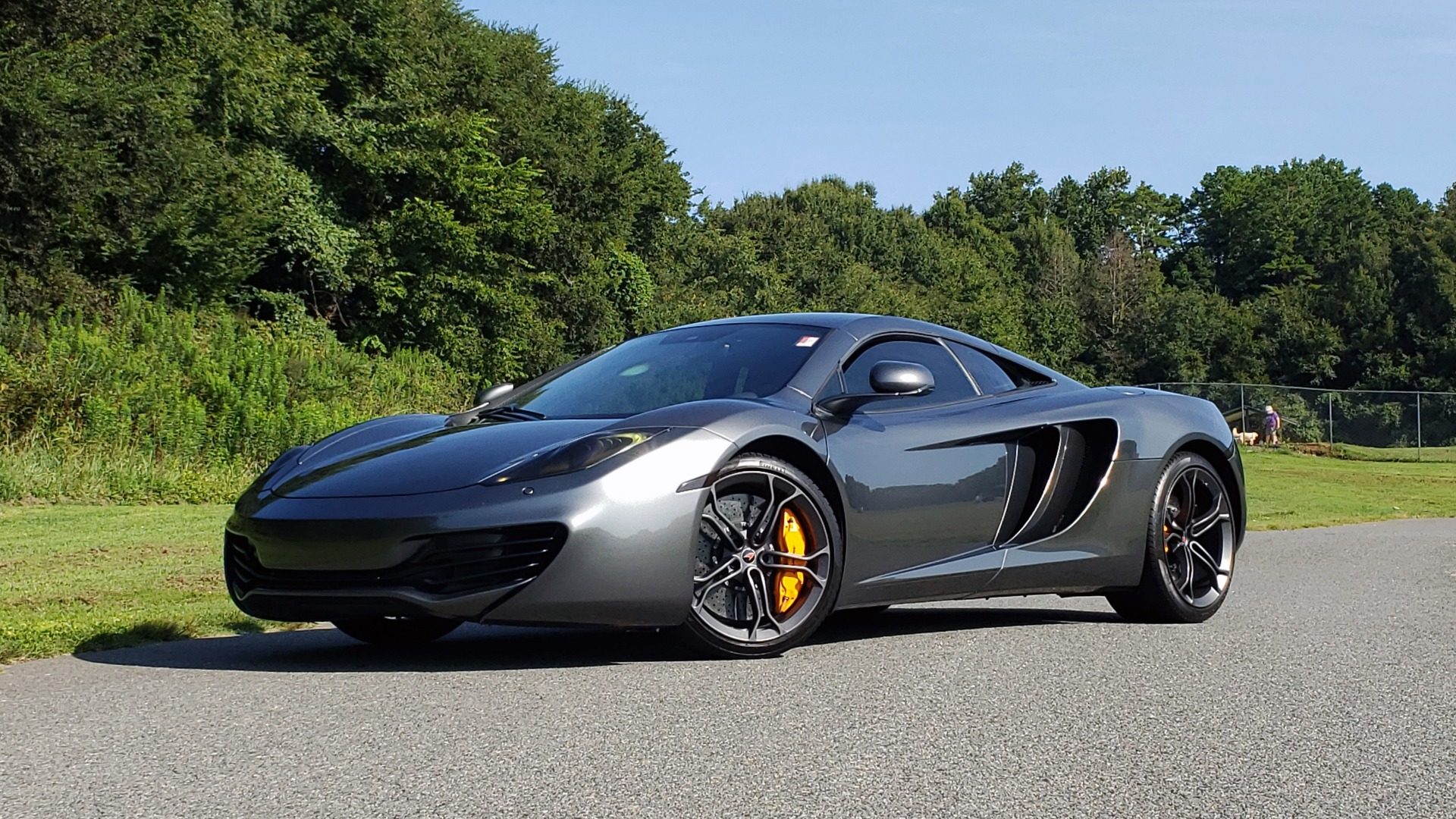 Used 2012 McLaren MP4-12C COUPE / 3.8 L V8 592HP / AUTO / NAV / CCB / LOW MILES for sale $97,999 at Formula Imports in Charlotte NC 28227 1