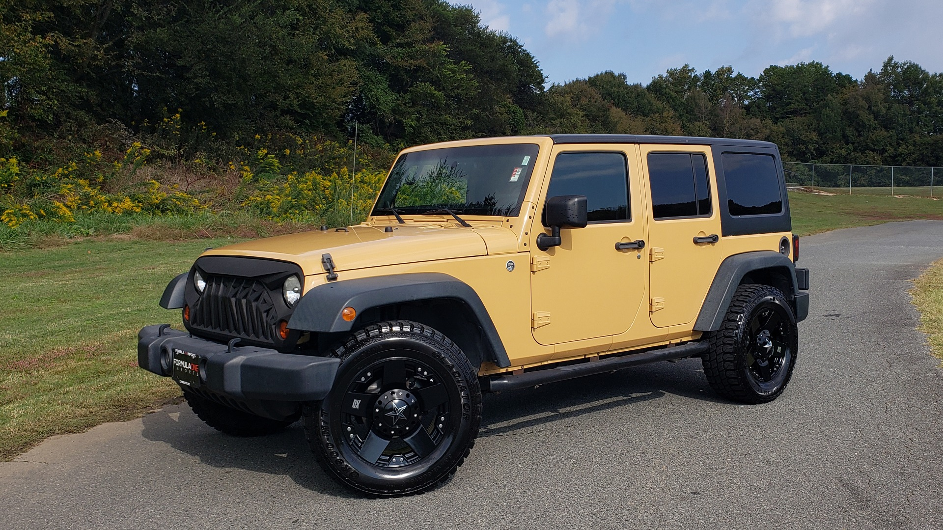 Used 2013 Jeep WRANGLER UNLIMITED SPORT 4X4 / 3.6L V6 / 5-SPD AUTO / 3-PC FREEDOM TOP for sale Sold at Formula Imports in Charlotte NC 28227 3