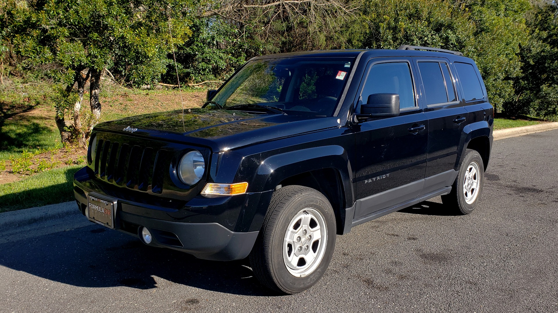 Used 2014 Jeep PATRIOT SPORT / 4WD 4-DR / POWER VALUE GRP / 4-CYL / 6-SPD AUTO for sale Sold at Formula Imports in Charlotte NC 28227 1