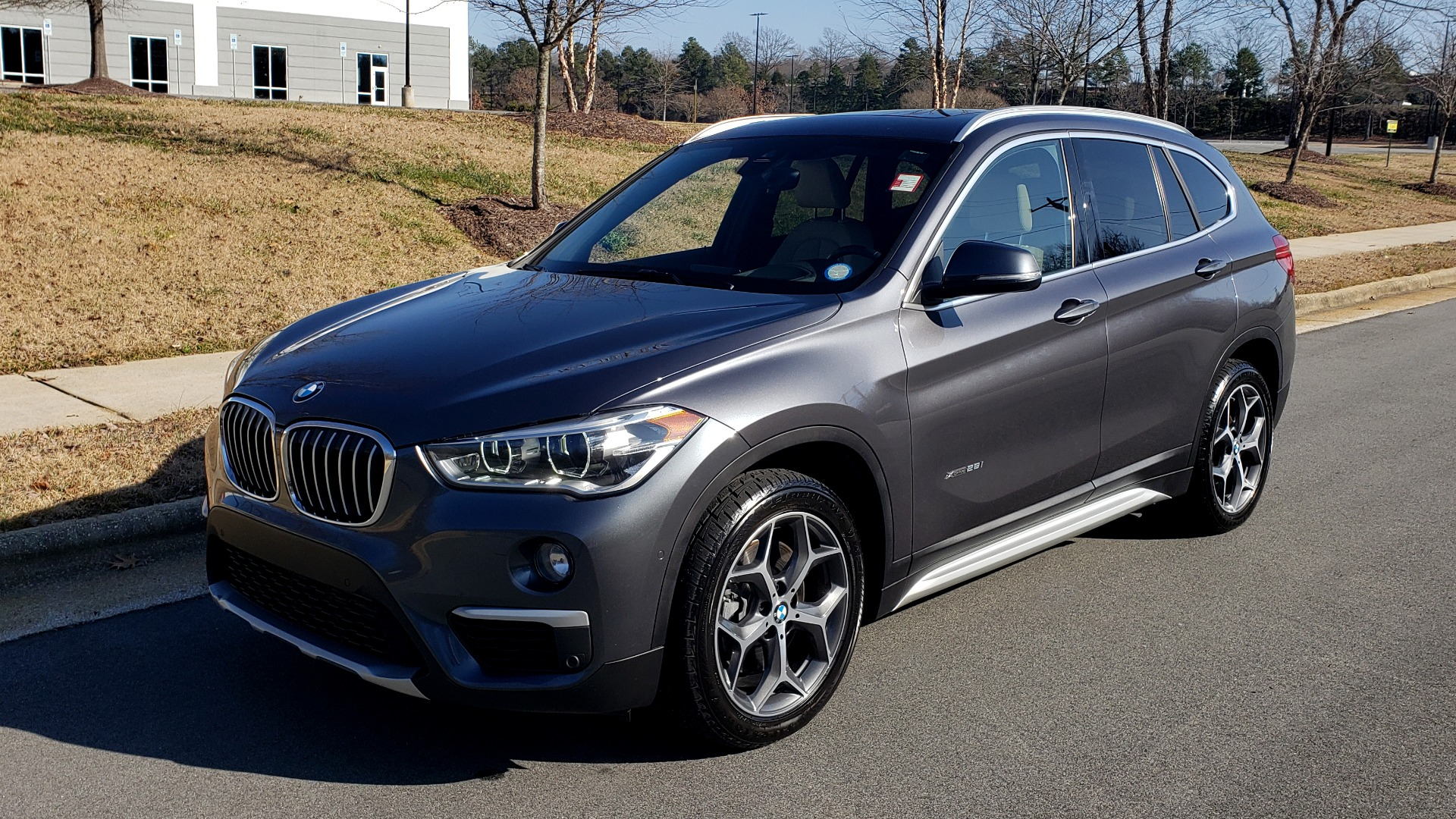 Used 2017 BMW X1 XDRIVE28I / PREM / TECH / DRVR ASST PLUS / COLD WTHR / REARVIEW for sale $26,995 at Formula Imports in Charlotte NC 28227 1